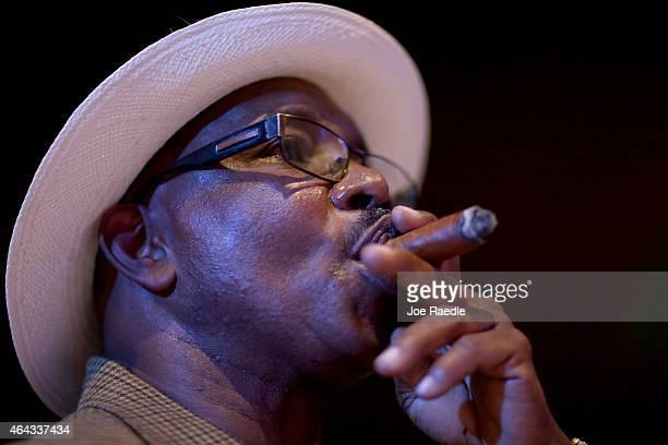 Cigar aficionado enjoys a cigar during the opening gala night of the week-long International Habano Cigar Festival on February 23, 2015 in Havana,...