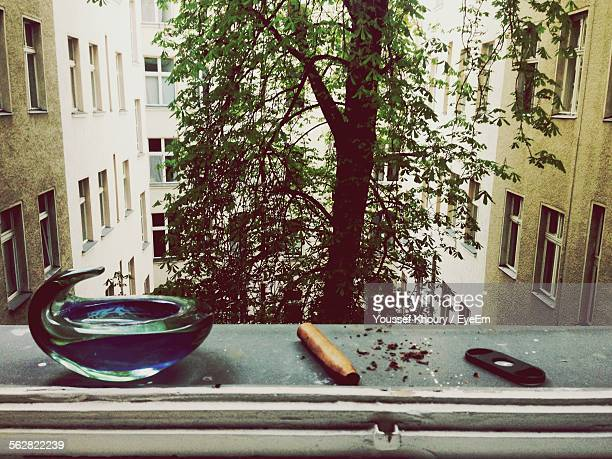 Cigar And Ashtray On Window Sill