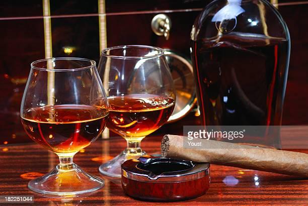 Cigar, Ashtray, Cognac and Humidor as Background