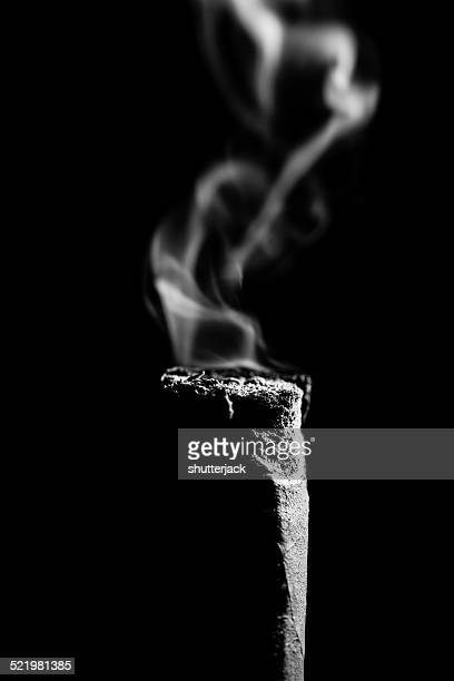 Cigar Butt and smoke on black background