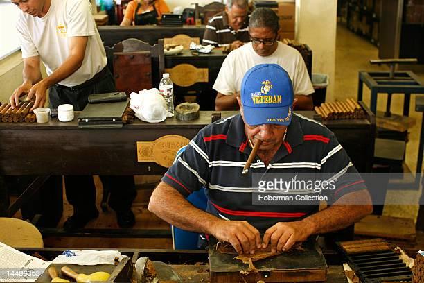 Cigar Roller Smoking a Cigar, Cuban Crafters, Miami