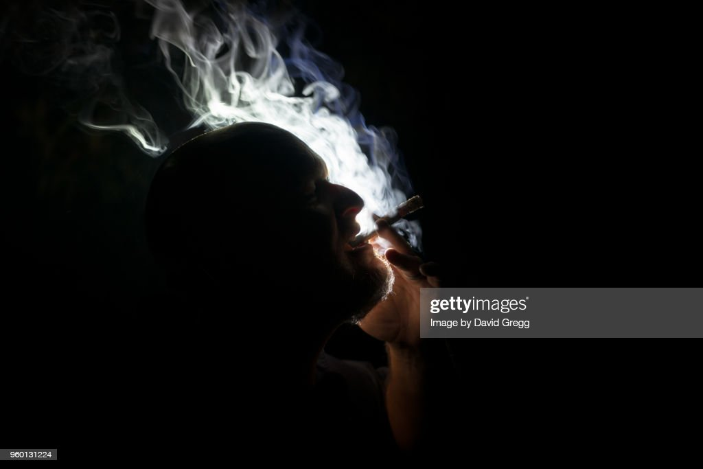 Cigar Smoke Dances in the Light 5 : Stock-Foto