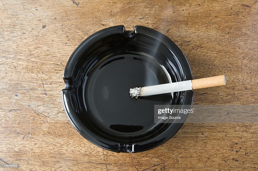 Cigarette burning : Stock Photo