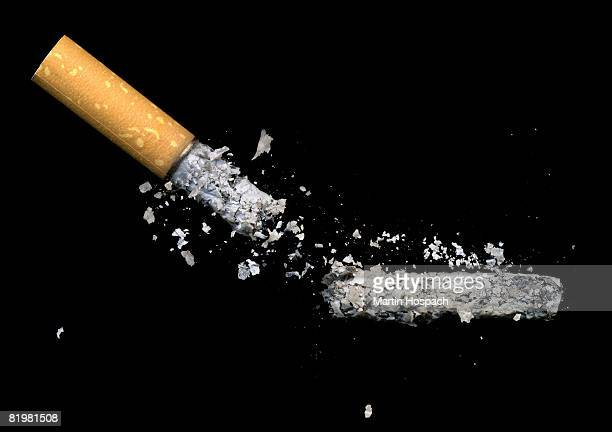 a cigarette butt and ash - ash stock pictures, royalty-free photos & images