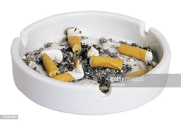 Cigarette butts in ash tray