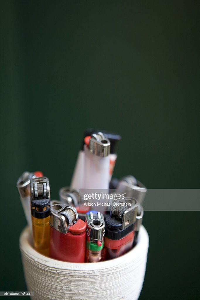 Cigarette lighters in cup, close-up : Foto stock