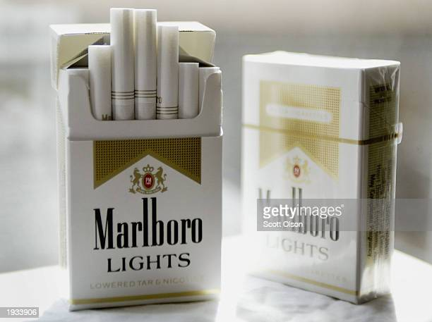 Cigarette maker Phillip Morris USA announced it has started removing the controversial words 'lowered tar and nicotine' from packages of Marlboro...