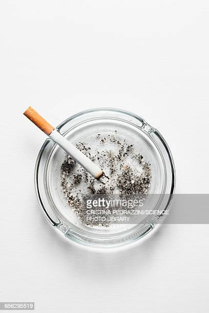 Cigarette on ash tray with ash