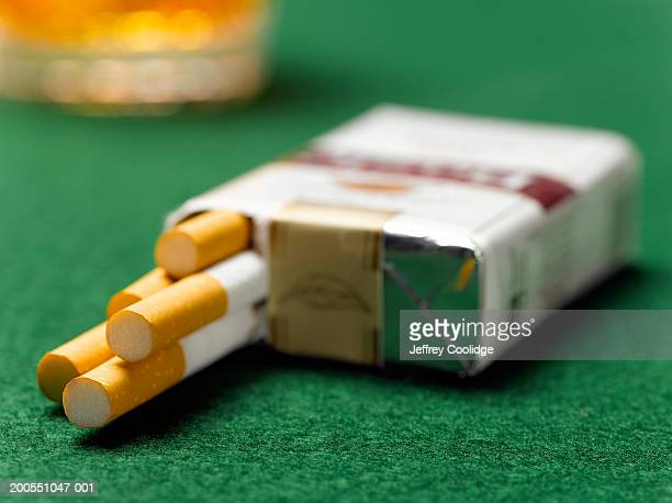cigarette pack open on table, close-up - cigarette pack stock pictures, royalty-free photos & images