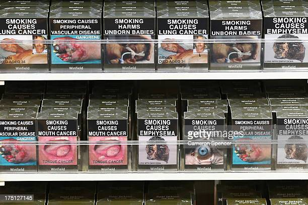 Cigarette packets with health warnings are displayed in a convenience store on August 1 2013 in Sydney Australia In a plan announced today the...