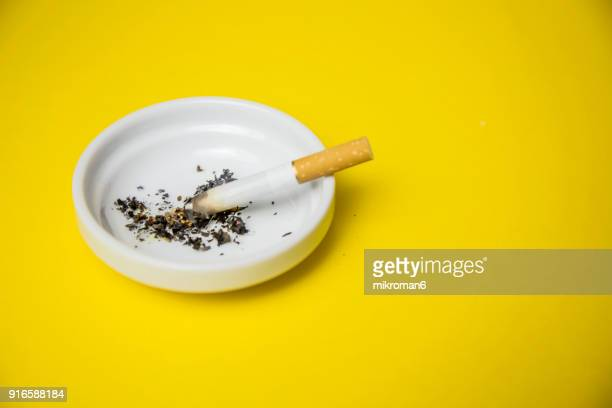 cigarettes and butts in ashtray - smoking issues stock pictures, royalty-free photos & images