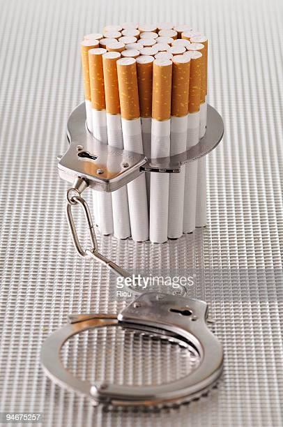 Cigarettes and handcuffs.