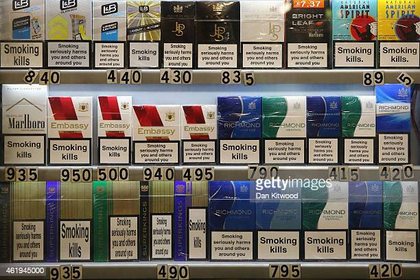 Cigarettes are sold in an off license on January 22 2015 in London England A law that would introduce cigarettes being sold with plain packaging...