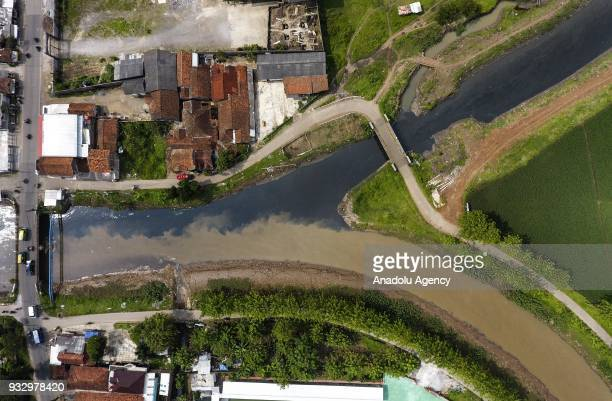 Cikijing River which was contaminated due to the waste of textile factories meets with the Citarum River flow that has not been exposed to waste in...