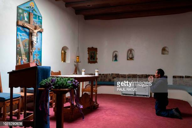 Cilbino Fausto, from Guatemala, makes a final prayer as everyone leaves after praying the Rosary in the chapel of Holy Cross Retreat Center in Las...