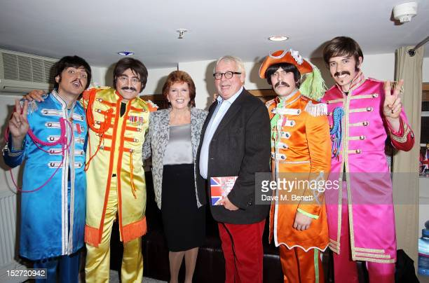 Cilla Black and Christopher Biggins pose backstage with the cast of 'Let It Be' during the interval of the press night performance at The Prince Of...