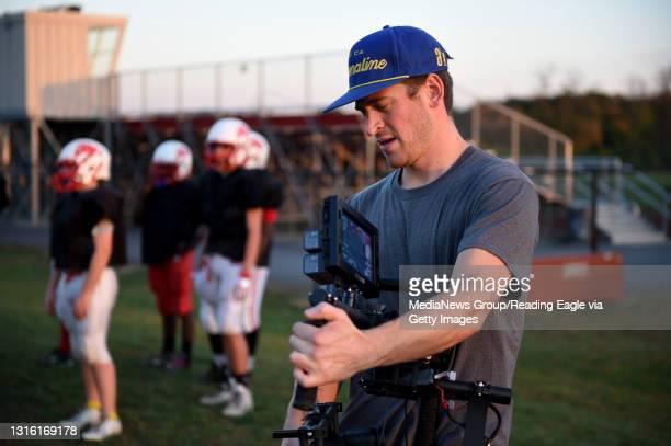 Cinamatographer Adam Koontz films Timothy Mashburn during Van Reed Midget football practice at Wilson West Middle School. Mashburn, who has...