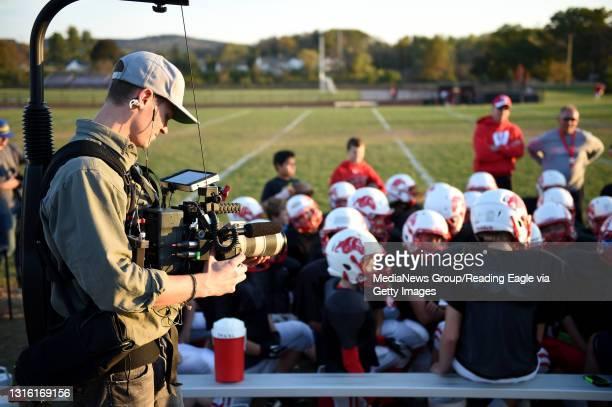 Cinamatographer Jason Koontz films Timothy Mashburn during Van Reed Midget football practice at Wilson West Middle School. Mashburn, who has...