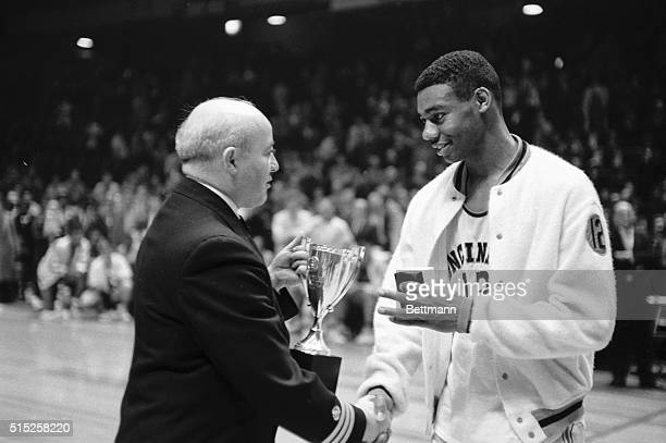 Cincinnati basketball ace Oscar Robertson is shown after landing his team to the championship of the Holiday Festival basketball tourney here, Dec....