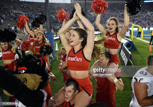 Cincinnati Bearcats cheerleaders celebrate in the end zone after the Bearcats defeated the UCLA Bruins 26 to 17 in a college football game played on...