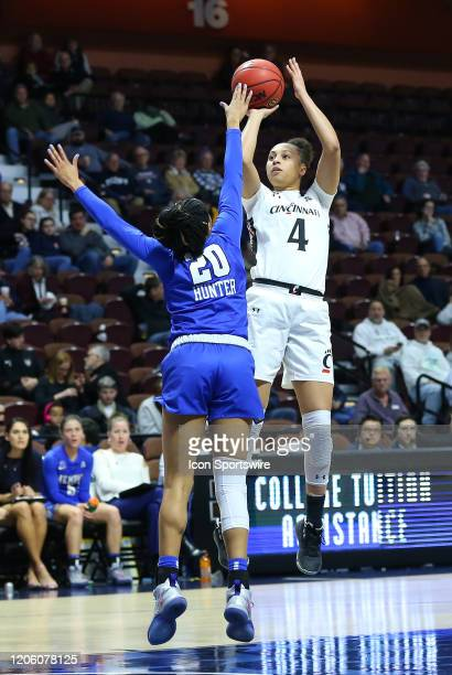 Cincinnati Bearcats forward Angel Rizor shoots over Memphis Tigers forward Keke Hunter during the women's American Athletic Conference Tournament...