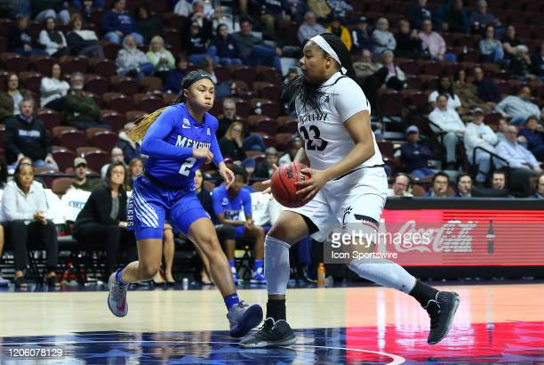 Cincinnati Bearcats forward Iimar'i Thomas drives to the basket during the women's American Athletic Conference Tournament game between Memphis...