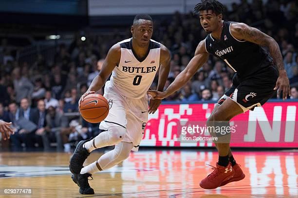 Cincinnati Bearcats forward Jacob Evans defends Butler Bulldogs guard Avery Woodson during the NCAA men's basketball game between the Butler Bulldogs...