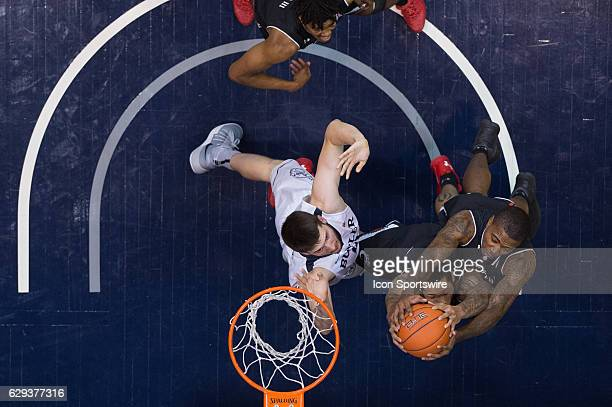 Cincinnati Bearcats forward Quadri Moore and Cincinnati Bearcats forward Gary Clark both grab a rebound during the NCAA men's basketball game between...
