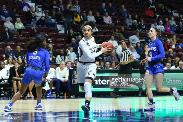 Cincinnati Bearcats guard Addaya Moore drives past Memphis Tigers guard Gazmyne Herndon during the women's American Athletic Conference Tournament...