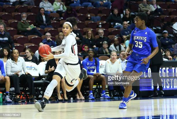 Cincinnati Bearcats guard Addaya Moore drives past Memphis Tigers guard Julan McDonald during the women's American Athletic Conference Tournament...