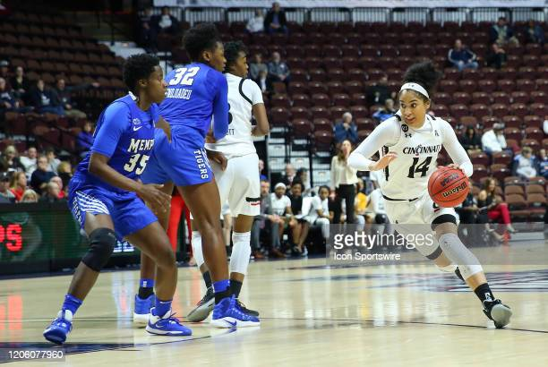 Cincinnati Bearcats guard Addaya Moore drives to the basket during the women's American Athletic Conference Tournament game between Memphis Tigers...