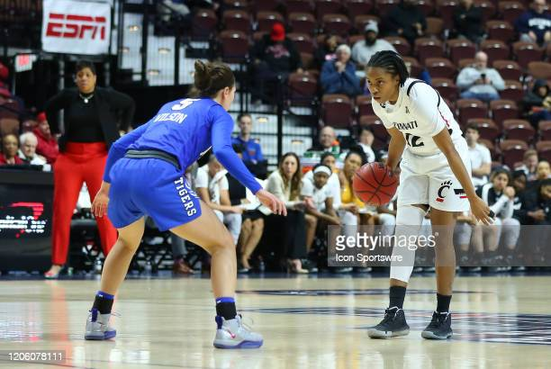 Cincinnati Bearcats guard Antoinette Miller defended by Memphis Tigers guard Aerial Wilson during the women's American Athletic Conference Tournament...