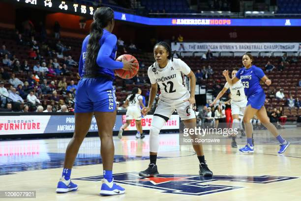 Cincinnati Bearcats guard Antoinette Miller defends Memphis Tigers guard Gazmyne Herndon during the women's American Athletic Conference Tournament...