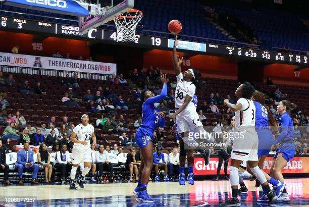 Cincinnati Bearcats guard Florence Sifa drives to the basket during the women's American Athletic Conference Tournament game between Memphis Tigers...