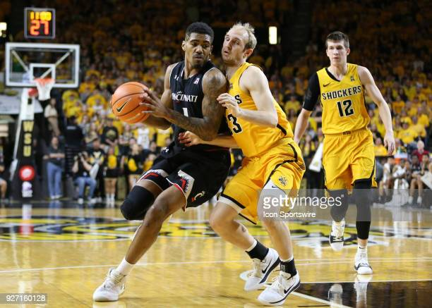 Cincinnati Bearcats guard Jacob Evans drives against Wichita State Shockers guard Conner Frankamp in the first half of an American Athletic...