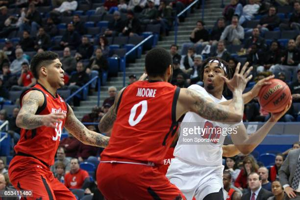 Cincinnati Bearcats guard Jarron Cumberland and Cincinnati Bearcats forward Quadri Moore doubleteam SMU Mustangs forward Ben Moore during the first...