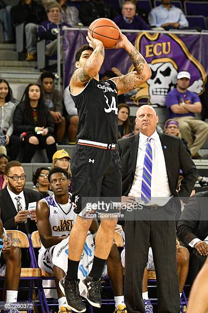 Cincinnati Bearcats guard Jarron Cumberland takes a three point attempt in front of East Carolina Pirates head coach Jeff Lebo in an American...