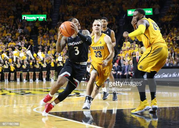 Cincinnati Bearcats guard Justin Jenifer gets past Wichita State Shockers guard Conner Frankamp in the first half of an American Athletic Conference...