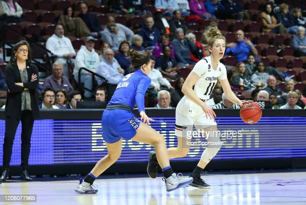 Cincinnati Bearcats guard Sam Rodgers defended by Memphis Tigers guard Aerial Wilson during the women's American Athletic Conference Tournament game...