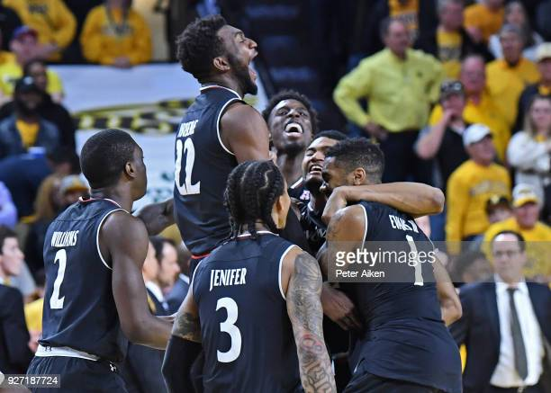 Cincinnati Bearcats players celebrate after beating the Wichita State Shockers on March 4 2018 at Charles Koch Arena in Wichita Kansas