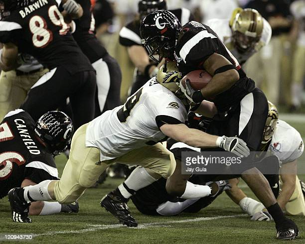 Cincinnati Bearcats running back Butler Benton fights for yardage versus the Western Michigan Broncos in the International Bowl at Rogers Centre in...