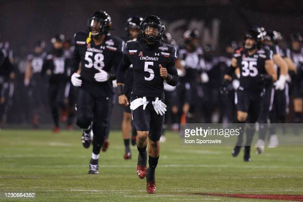 Cincinnati Bearcats safety Darrick Forrest runs onto the field before the AAC Championship game against the Tulsa Golden Hurricane and the Cincinnati...