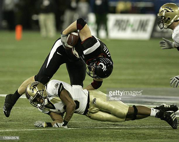 Cincinnati Bearcats tight end Brent Celek is upended by Western Michigan Broncos Londen Fryar in the International Bowl at Rogers Centre in Toronto,...