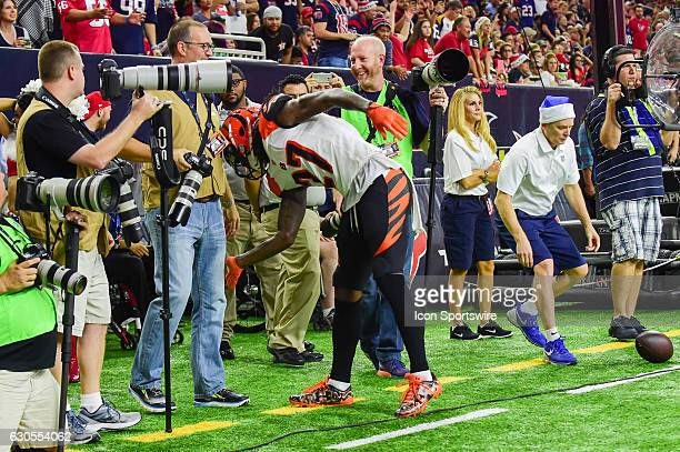 Cincinnati Bengals Cornerback Dre Kirkpatrick mockingly cleans the pant leg of a photographer after he was hit with a deflected pass during the NFL...