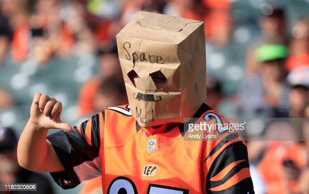 Cincinnati Bengals fan wears a bag on his head during the game against the Jacksonville Jaguars at Paul Brown Stadium on October 20 2019 in...