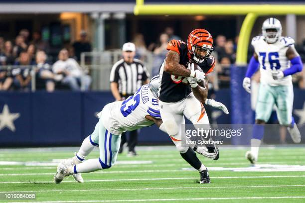 Cincinnati Bengals fullback Cethan Carter evades Dallas Cowboys linebacker Justin MarchLillard during the game between the Dallas Cowboys and the...
