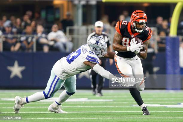 Cincinnati Bengals fullback Cethan Carter runs through Dallas Cowboys linebacker Justin MarchLillard during the game between the Dallas Cowboys and...