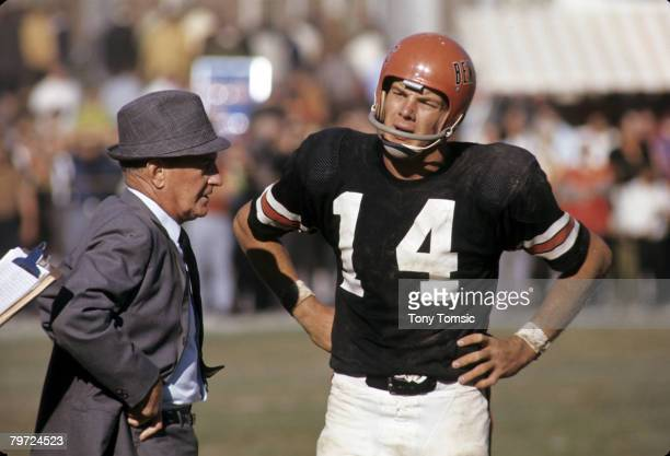Cincinnati Bengals Hall of Fame head coach Paul Brown talks with quarterback Sam Wyche during a game in 1969