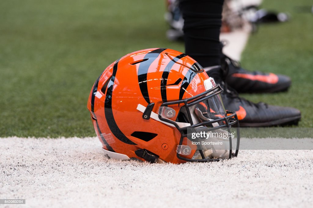 Cincinnati Bengals helmet lays on the field during the NFL preseason game between the Cincinnati Bengals and Indianapolis Colts on August 31, 2017, at Lucas Oil Stadium in Indianapolis, IN.