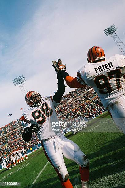 Cincinnati Bengals linemen Todd Kelly and Mike Frier high five each other while celebrating on the sideline during game against the Cleveland Browns...